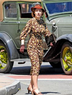 mildred pierce- love the slashes to the elbow on the sleeves of this otherwise drab looking dress