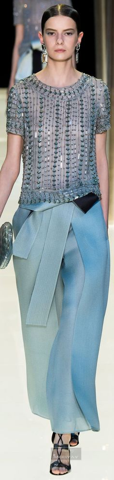 Armani Privé.  Spring 2015 Couture--The beading on the blouse is interesting and goes well with the texture and drape of the pants.  A draped blouse looks best if you have a small-to-moderate bust.  If your bust is large, you should go for looks that show the waist.
