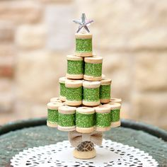 Use tiny wood spools to make a miniature Christmas tree ornament or decorative piece.