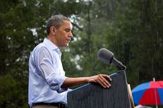 """""""The President delivers remarks in the pouring rain at a campaign event in Glen Allen, Va. He was supposed to do a series of press interviews inside before his speech, but since people had been waiting for hours in the rain he did his remarks as soon as he arrived at the site so people could go home to dry off ."""" (Official White House Photo by Pete Souza)"""