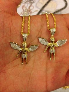 New micro angel pendants.  Real 10k Yellow Gold with Genuine Diamonds.   Comes with free matching Miami Cuban link, Moon Cut, or Popcorn chain.   (Free chain is .925, with yellow gold finish. If you would like a 10k gold chain please add $250 for each one.)  Appx .25 carat total weight in dia