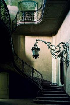A stairway and matching wall lighting element.... In an abandoned place.
