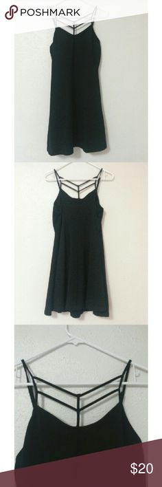 Strappy Black Dress Black dress with straps across the chest. Worn once Express Dresses