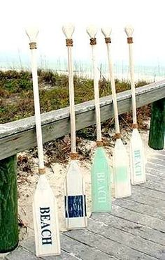 Painted oars for home decor: http://www.caronsbeachhouse.com/painted-coastal-oars-and-paddles/ Beach oars, coastal oars and nautical oars.