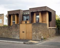 The studio wanted to integrate the wall in the home to anchor the home within the site. The house is entered through the wall and it supports one side of the new structure. Natural Architecture, British Architecture, Amazing Architecture, Brick Facade, Facade House, Brick Wall, London Townhouse, London House, Timber Windows