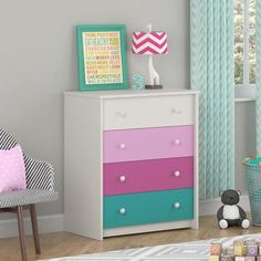 This Kids Girls Bedroom 4-Drawer Dresser in White Pink Raspberry Turquoise features a white stipple, urban pink, raspberry and turquoise drawer to fit in with y