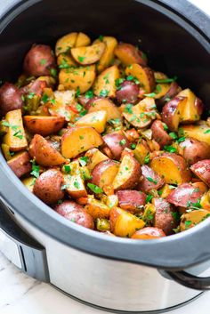 Crockpot Breakfast Potatoes. Crisp, tender potatoes with peppers and onions made EASY in the slow cooker. Perfect for holidays and always a family favorite!