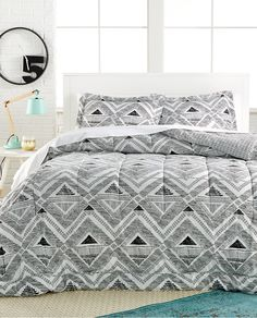 The geometric black & white pattern acts has a neutral palette, making it easy to add décor pieces in pops of your favorite color.