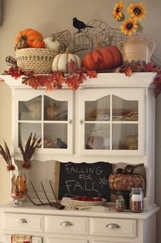 Fall hutch decor.  I should be able to do this with all my wedding decorations! @Rob Lowe