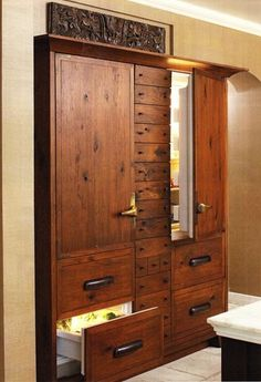 I love these refrigerators that don't look like refrigerators.  They look like built in cabinets.  Pretty.