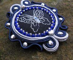 Soutache brooch with textil button.