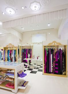 "Just absolutely perfect. i WANT THIS STORE. Note the mirrored ends of the ""closets"", the white upholstered seating area, the chiffon curtain, the ceiling medallions and lighting... Ohhh! Just replace the table with a sales counter mimiking the rack design, and done. LOVE my vision store!"