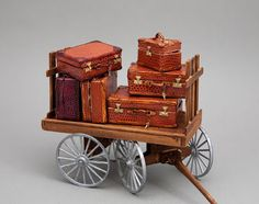 Miniature Handcrafted leather luggage on cart in 1/12 scale.