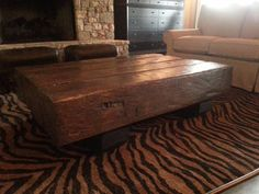 coffee table I built out of reclaimed  hand hewn heart pine 10 x 10 beams