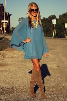 Flowy misty-teal mini dress, tan suede boots, statement necklace