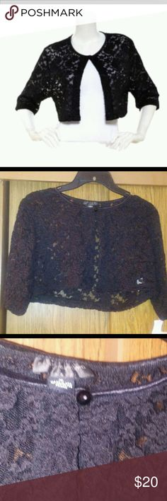 Black lace shrug Brand new with tag Color black floral lace shrug 3/4 elbow knee length sleeve and 1 button closure Size M Connected Apparel Sweaters Shrugs & Ponchos