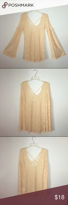 Urban Outfitters Lace Bell Sleeve Top Staring at Stars lace bell sleeved top in ivory. Scoop neck. Cross back detailing. Like new. Also works great as a swim cover up. I ship right away! Discounts on bundles! I'm open to offers Urban Outfitters Tops Blouses
