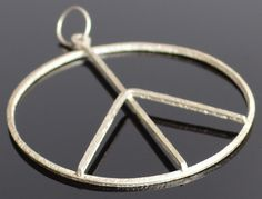 A personal favorite from my Etsy shop https://www.etsy.com/listing/214179756/2-inch-wide-peace-sign-hammered-in