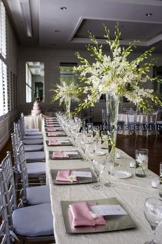 For the bouquets we used ivory and pink roses. They were mixed with hydrangeas for the aisle and the gazebo which was used for the ceremony. The centerpieces were a firework for #whitedendrobriumorchids placed upon #talltrumpetvases for a #whiteweddingcenterpiece http://vasemarket.com/glass-vases/trumpet-vase
