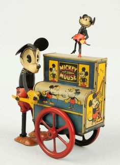 "German. Wind-up. One of the most desirable early tin litho Mickey Mouse toys. Is all original including Mickeys arms, ears and Minnie who dances on top of roof when toy is in operation. Beautiful color lithography of Mickey Mouse on all sides. Some minor scratching and wear. Missing original tail. Condition (Excellent). Size 6"" L."
