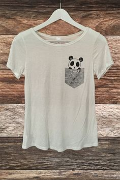 Off white soft and lightweight top featuring an adorable graphic panda print. 95% Rayon / 5% Spandex Made in USA