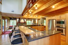 Light wood kitchen design with large u-shaped island and eat-in counter. I love EVERYTHING about this kitchen