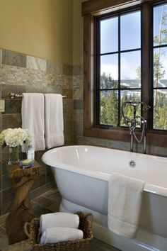 We have already decided with Kristi and Renee that we are not going to do a free-standing tub.  We have discussed the layout of the master bath, and they are working on the specs for us.  This picture encapsulates what we are after, that the house should be a reflection of the nature outside.  We both love the tile in this bathroom, and use of the natural wood as an accent piece.