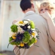 green, ivory, yellow, and purple wedding bouquet