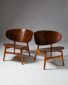 Shell chairs designed by Hans Wegner for Fritz Hansen, — Modernity