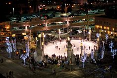 Families enjoy hot cocoa and free skating on the ice rink at Main Street Square in Rapid City.
