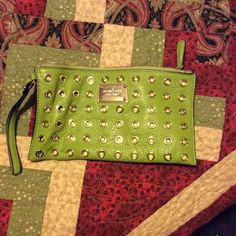 Authentic Michael Kors wristlet Authentic Michael Kors wristlet. Bright green with gold accents. Michael Kors Bags Clutches & Wristlets