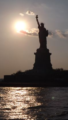 statue of liberty at sunrise new york places to liberty sunrise nycacirc153yennyc explore the world travel nerd nici one