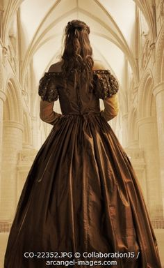 A princess with a long flowing dress stands in a cathederal Photographer: CollaborationJS