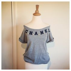 Vintage Grey Embellished Tee This is from the 80s so it's technically vintage GRIN it was purchased on Etsy from a designer specialising in revamped garments. She created the words CHANEL out of Black Felt then embellished the bodice further with, what else, faux pearls. The Felt could do with a little brushing but beyond that and very slight piling, this top is is fantastic condition. Tops Tees - Short Sleeve
