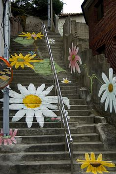 Street Art, beautiful painting daisies in yellow pink and white, painted on steps. Amazing. Please also visit www.JustForYouPropheticArt.com for colorful inspirational Art. Thank you so much! Blessings!