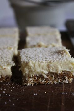lemon bars with coconut - Base: 3/4 cup oats (or buckwheat groats if you want it gluten-free) 3/4 cup dates 3/4 cup coconut shreds Lemon layer: 1/3 cup melted coconut oil 1/4 cup maple syrup (or 1 cup dates, but this will change the colour) Juice from 3 lemons 1/2 cup coconut shreds 1 or 2 bananas