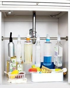 Tension Rod Storage: Who knew your cleaning products could look so cool? Conquer under-the-sink chaos and clutter with the help of a humble little tension rod. Suddenly cleaning doesn't seem so daunting. (via Martha Stewart) Organisation Hacks, Under Sink Organization, Organizing Hacks, Sink Organizer, Kitchen Organization, Cleaning Hacks, Cleaning Supplies, Cleaning Products, Organizers