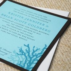 Coral Beach Wedding Invitation- Whimsical coral swim in a sea of shimmery Tiffany blue - ideal for a seaside wedding ceremony. Chocolate accents and ivory linen add delightful contrast to this elegant beach-themed invitation.