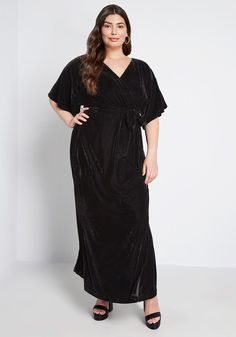 Plus Size Black Velvet Wrap Maxi Dress Short Sleeves Women's.  Beautiful black maxi dress plus size in a rich black velvet fabric, kimono-style half sleeves, and wrap-inspired skirt with sashed gown.   #PlusSizeDresses #getthelook #PlusSize #PlusSizeFashion #PlusSizeStyle #CurvyGirl #plussizedivas #boldcurvyfashionista #curvy #curvyfashionista #Fashion #Style