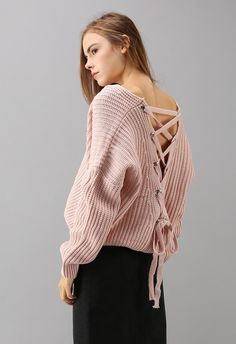 One-track mind? It's a good thing this sugary pink sweater with its lace-up back is no-brainer, huh?