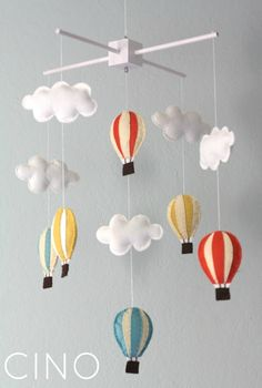 "Super adorable hot air balloon mobile from ""Craftiness in not Optional""... this would be even cuter if the hot air balloons were like the house/balloons in pixar's Up"