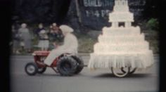 (1950's 8mm Vintage) Old Time Country Parade Floats. http://www.pond5.com/stock-footage/49511733?ref=StockFilm keywords:16mm, 2160, 3840, 4k, 8mm, Americana, amateur, archive, cinematography, classic, clips, film, floats, footage, golden age, grainy, home made, home movie, home video, innocent, memories, nostalgia, old, parade, preserve, project, projector, reel to reel, restore, retro, romance, small town, super 8, uhd, usa, vintage, latino ethnicity, indian ethnicity