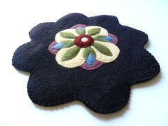 Handmade Wool and Wool Felt Candle Mat Penny Rug Table Topper Floral Design. $18.00, via Etsy.