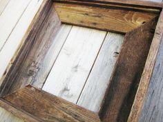 Beautiful reclaimed wood frames everywhere.  I love them!
