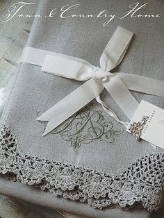 Gorgeous lace bordered monogrammed linens in French grey ~