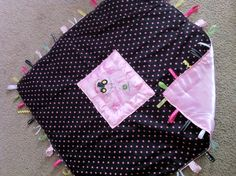girl john deere taggie 30x30 blanket..trying to get her attached to something other than my hair. might try this!