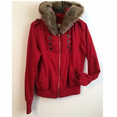 Military Faux Fur Hoodie This maroon hoodie has a military feel while still having a classy feel with it's faux fur hood making it easy to dress up or down. Features button accents on the chest and shoulders, zips up and has hip pockets. Barely Worn!                                              ✴️Fits like a Medium✴️                                       🌺Dry Clean Only🌺 Forever 21 Tops Sweatshirts & Hoodies