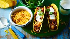 Tacos with a spicy bean filling and all the trimmings. The veggie bean filling can be made in advance and will keep in the freezer for 2 months, so whenever you fancy a veggie taco you can whip one up in minutes.