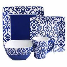 """An elegant stage for your culinary creations, this eye-catching earthenware dinnerware set showcases a damask motif in navy.  Product: 4 Dinner plates4 Salad plates4 Bowls4 MugsConstruction Material: EarthenwareColor: Navy and whiteFeatures: Damask motifMug has 12 Ounce capacityDimensions: Dinner Plate: 10.5"""" W x 10.5"""" DSalad Plate: 8.5"""" W x 8.5"""" DBowl: 3.25"""" H x 5.75"""" W x 5.75"""" DMug: 4.1"""" H x 3.5"""" Diameter"""