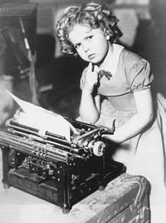 Shirley Temple behind the scenes of The Littlest Rebel, 1935.